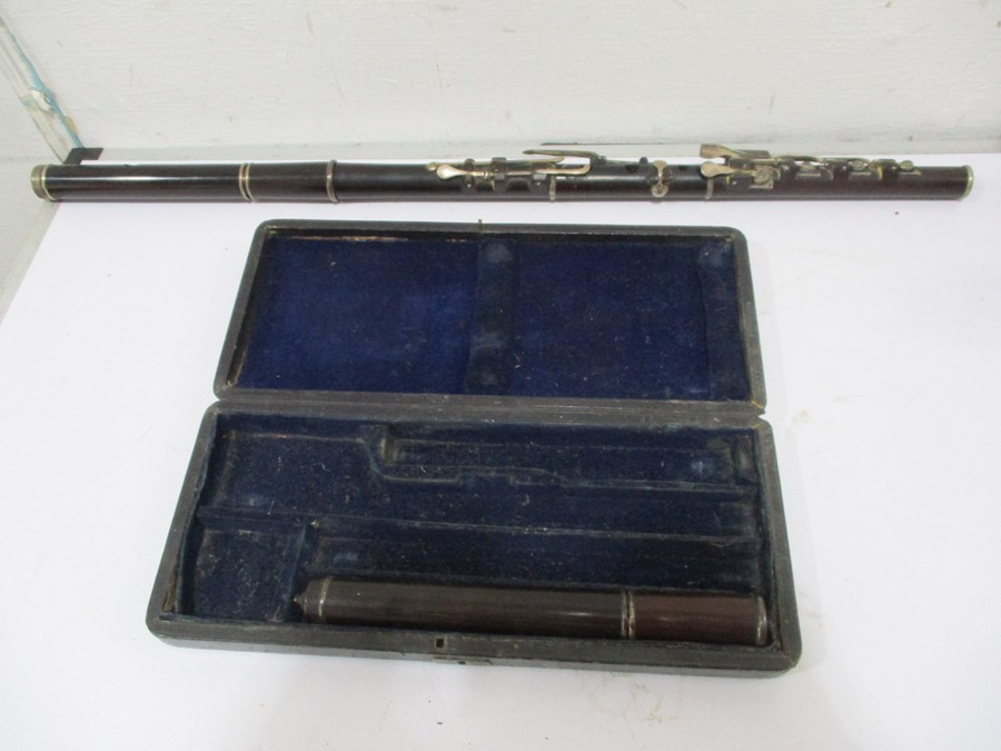Lot 276 - A 19th century cased Rudall & Rose flute with SCM mounts- some slight splitting to mouthpieces,