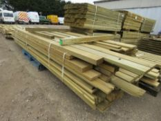 LARGE PALLET OF TIMBER POSTS AND USEFUL TIMBER 10-15FT LENGTH APPROX