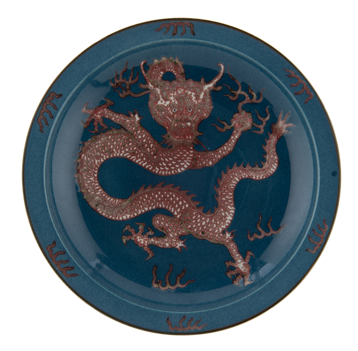 Lot 34 - A Chinese bleu poudré and copper red charger, the well decorated with a five clawed dragon amongst