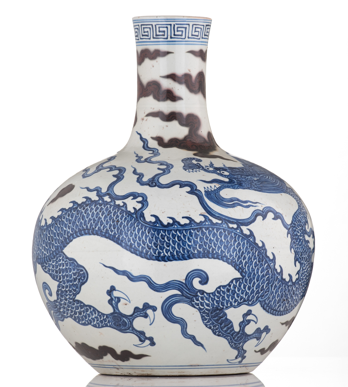Lot 29 - A Chinese cobalt blue and copper red bottle vase, decorated with a dragon amongst clouds, H 41 cm