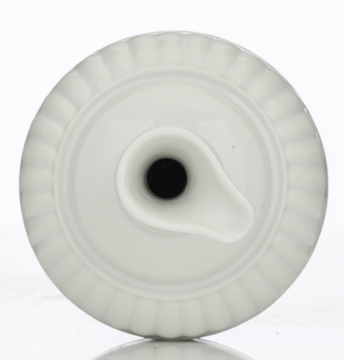 Lot 26 - A Chinese white glazed ewer with incised decoration, with a Yongzheng mark, H 20 cm