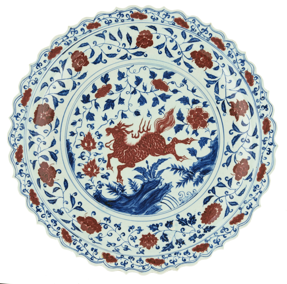 Lot 33 - An imposing Chinese cobalt blue and copper red Ming type charger, decorated with floral motifs and a