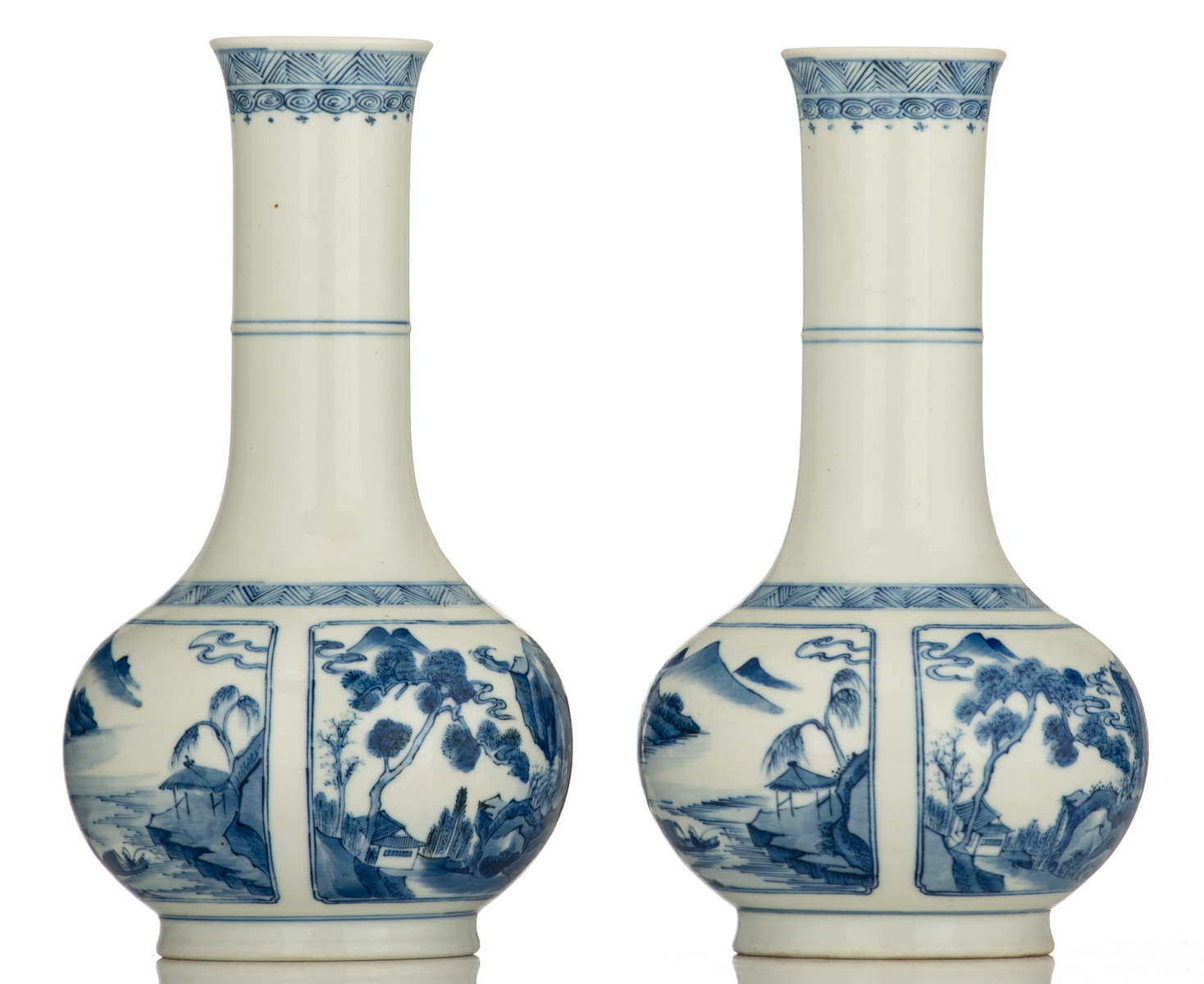 Lot 46 - Two Chinese blue and white porcelain bottle vases, decorated with fishes in a mountain lake, on