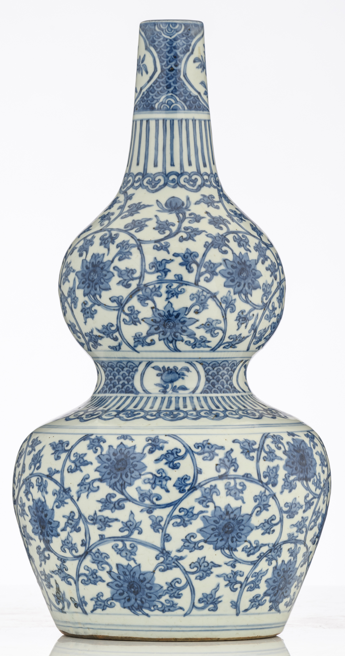 Lot 59 - A large Chinese Ming type blue and white double gourd vase, the bulbs decorated with lotus