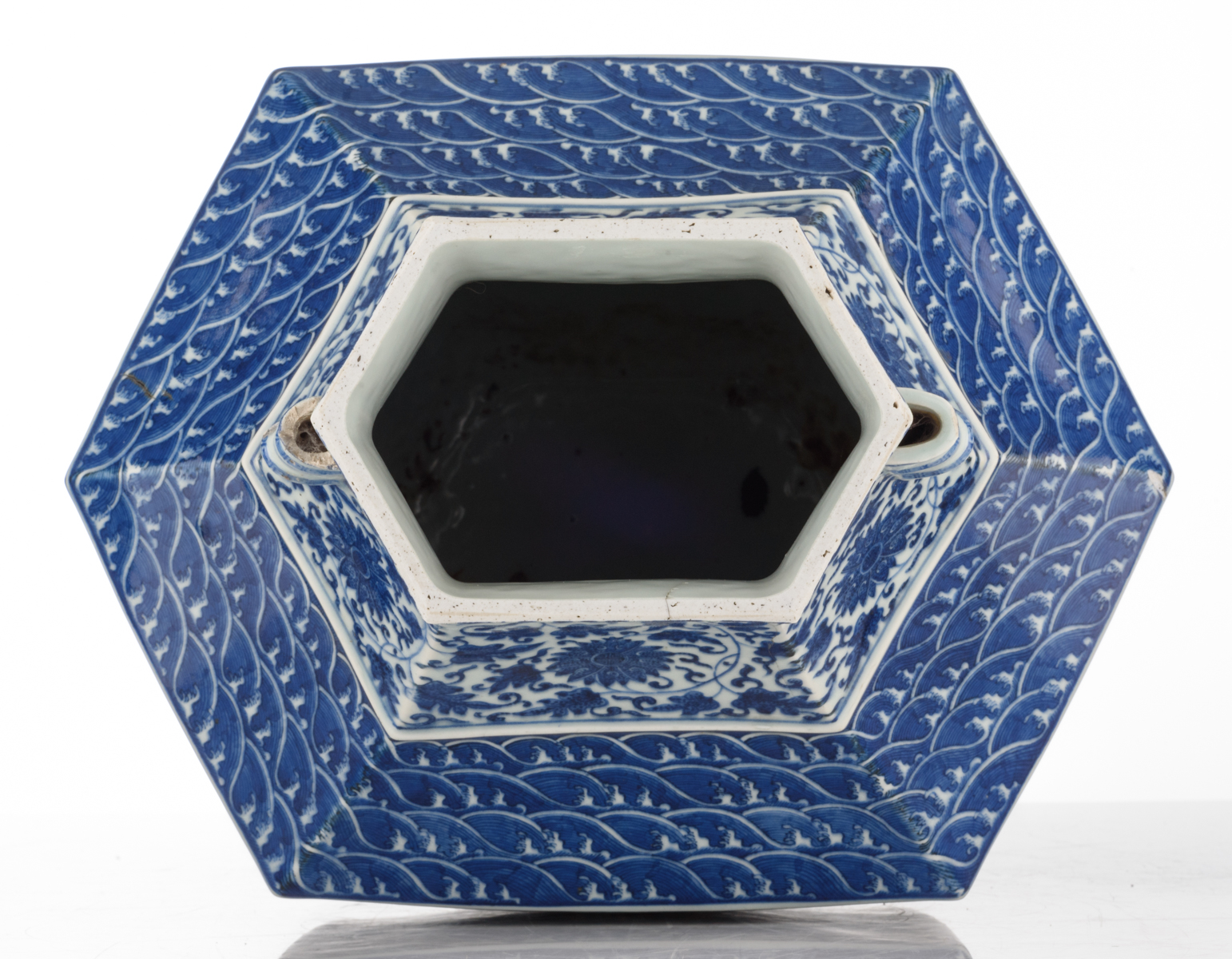 Lot 38 - A Chinese hexagonal blue and white hu vase, decorated with floral scrolls and shou signs on the