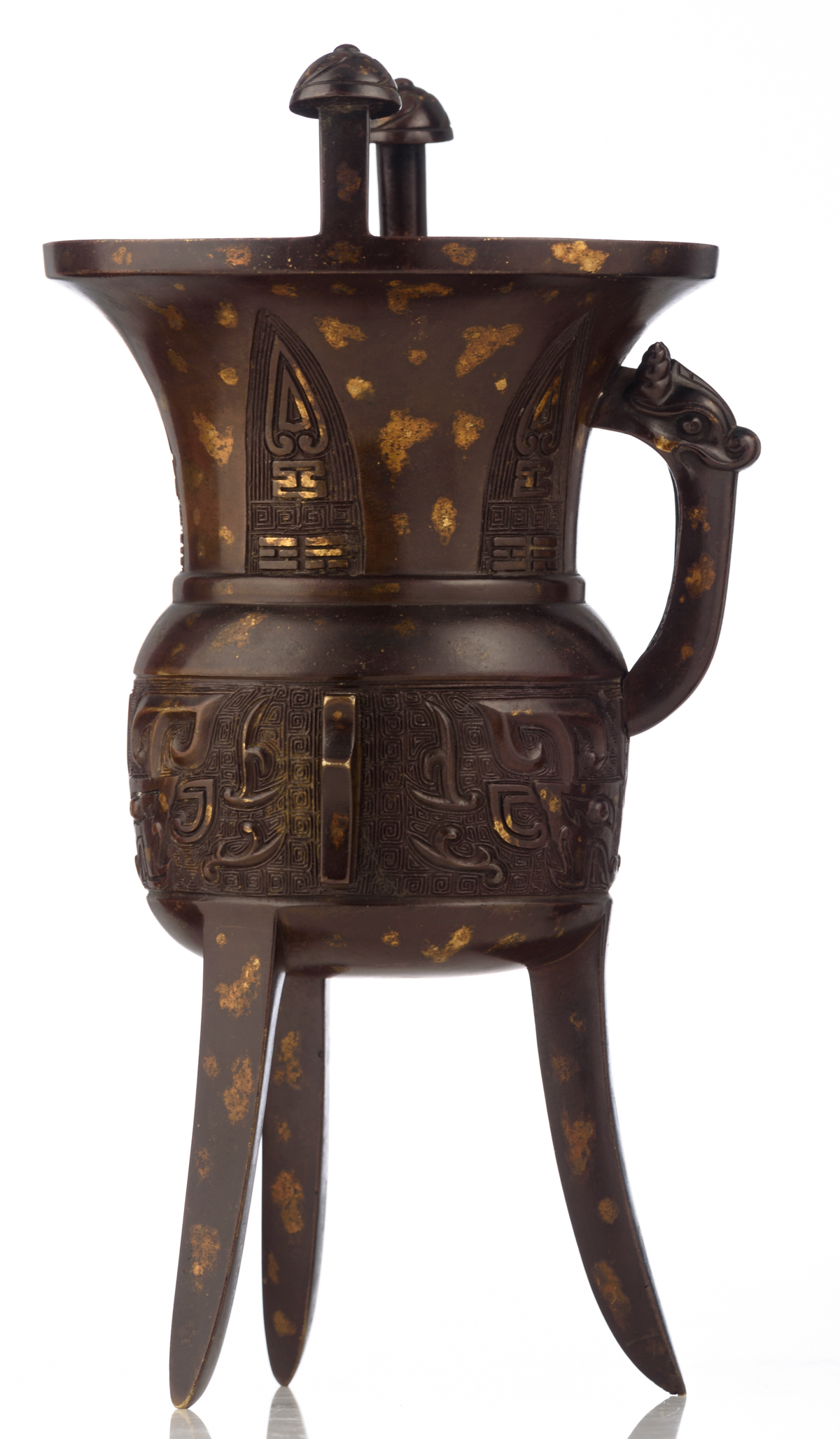 Lot 6 - An archaic bronze gold-splash decorated Jia tripod vessel, relief decorated with Taotie masks and