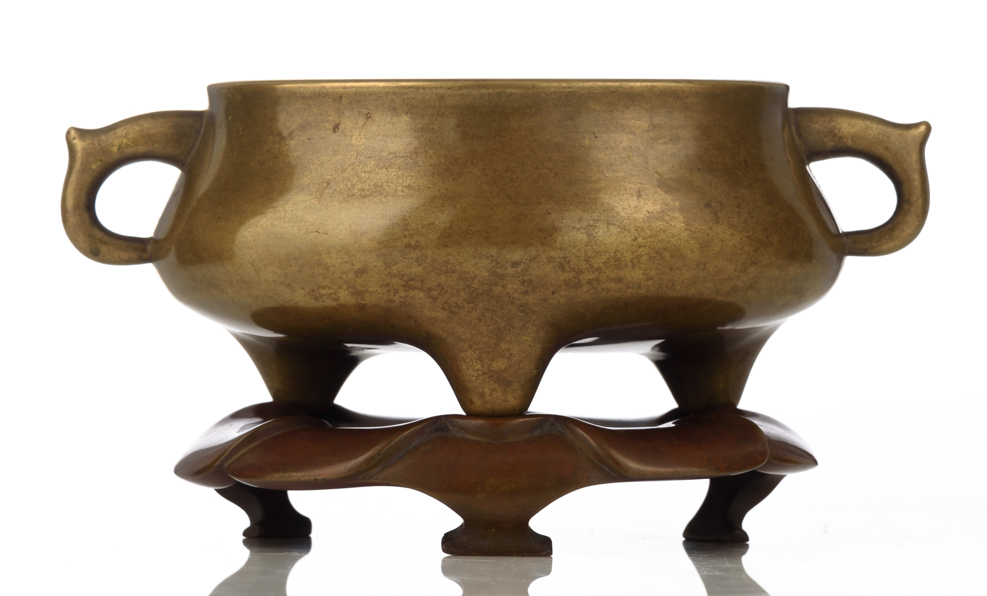 Lot 8 - A Chinese archaic bronze gui tripod incense burner on a matching red copper nymphaea shaped stand,