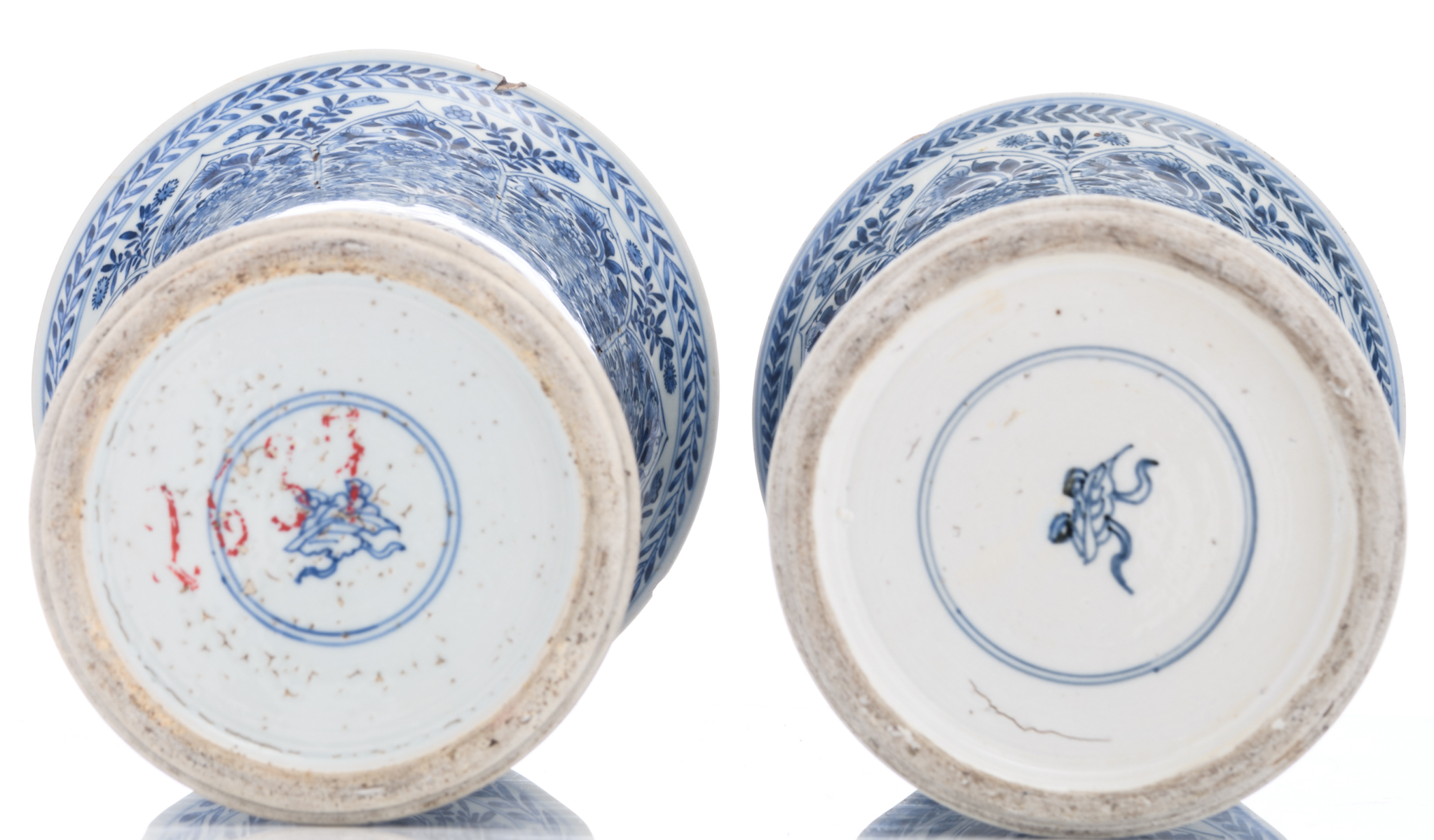 Lot 54 - A pair of Chinese blue and white floral decorated yenyen vases, marked Kangxi and period, mounted as