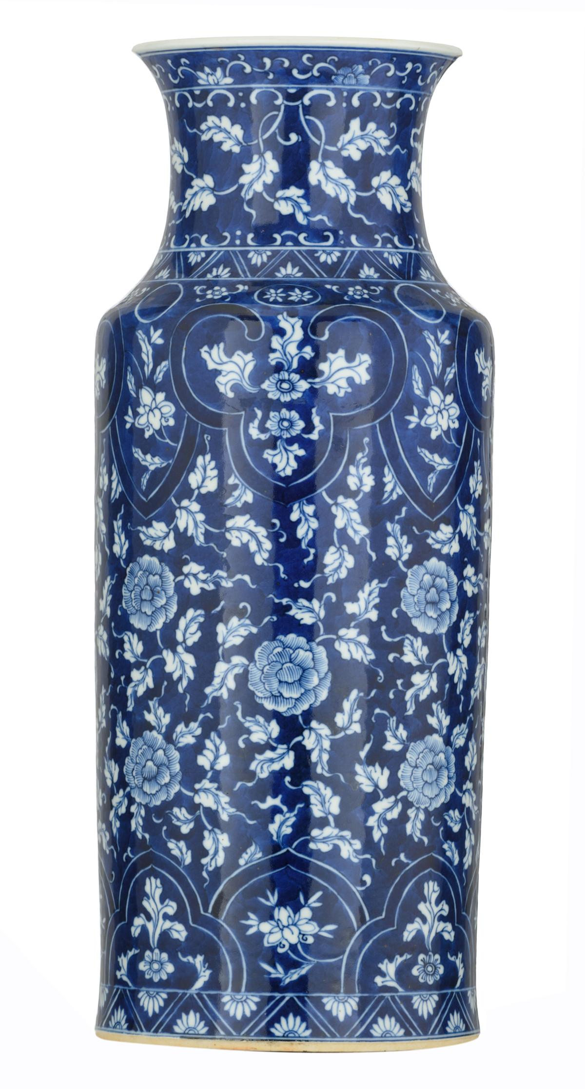 Lot 52 - A blue and white floral decorated porcelain rouleau vase, 19thC, H 47,7 cm