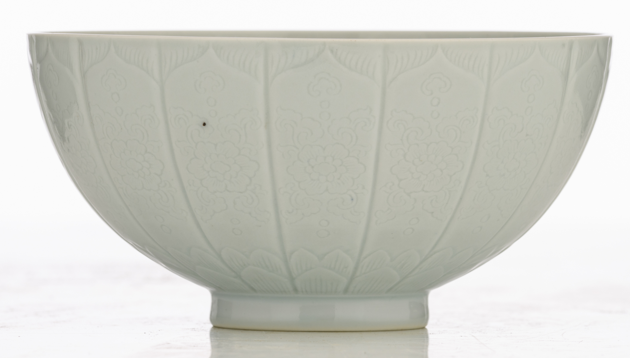 Lot 27 - A Chinese relief decorated white glazed 'lotus' bowl with incised lotus flower design, the