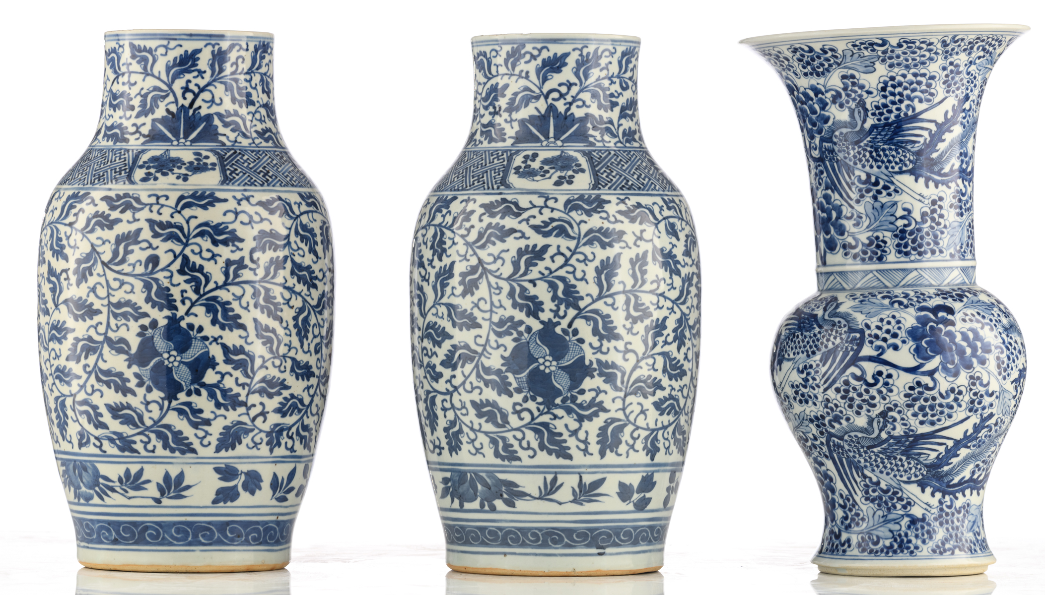 Lot 58 - A pair of Chinese floral decorated blue and white porcelain vases; added a ditto blue and white