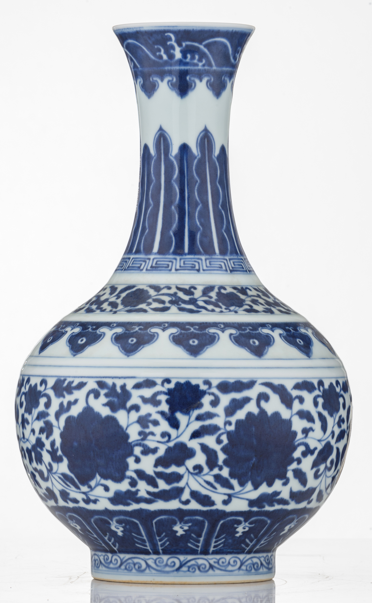 Lot 36 - A Chinese blue and white bottle vase, decorated with the design of a meandering foliate scroll, with