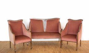 Zweisitzer und 2 SesselDeutschland, um 1920, dunkel gebeiztes Holz mit roter Polsterung, Sofa Höhe