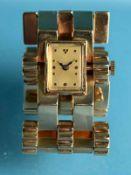 Gliederarmband mit Uhr, 70-er Jahre. 585/- Roségold. Gesamtgewicht ca. 82,8 g. Fünfreihiges