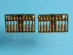 Paar Manschettenknöpfe, 20. Jh. 585/- Gelbgold. Gesamtgewicht ca. 6,9 g. Schauseite in plastischer