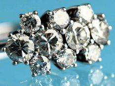 Ring mit 10 Brillanten, zusammen ca. 1,5 ct, 80-er Jahre. 585/- Weißgold. Gesmtgewicht ca. 4,2 g. In