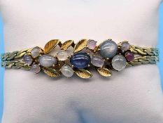 Armband mit 13 verschiedenen Sternkorunden-Cabochons, Goldschmiedearbeit, 70- er Jahre 585/-