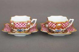 Paar LIMOGES MokkatassenPorzellan, 20. Jhdt., rosa Gitternetz mit Floraldekor und Goldstaffage,