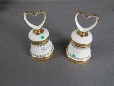 Zwei Tischglocken Porzellan Hersteller Sneorl 13,5cm- - -20.00 % buyer's premium on the hammer