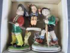 Konvolut drei Porzellanfiguren unter anderem Hummel Thüringen- - -20.00 % buyer's premium on the
