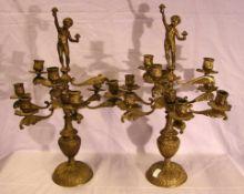 Paar Messingleuchter, mit Puttendarstellungen, 9-armig, H. ca. 53 cm
