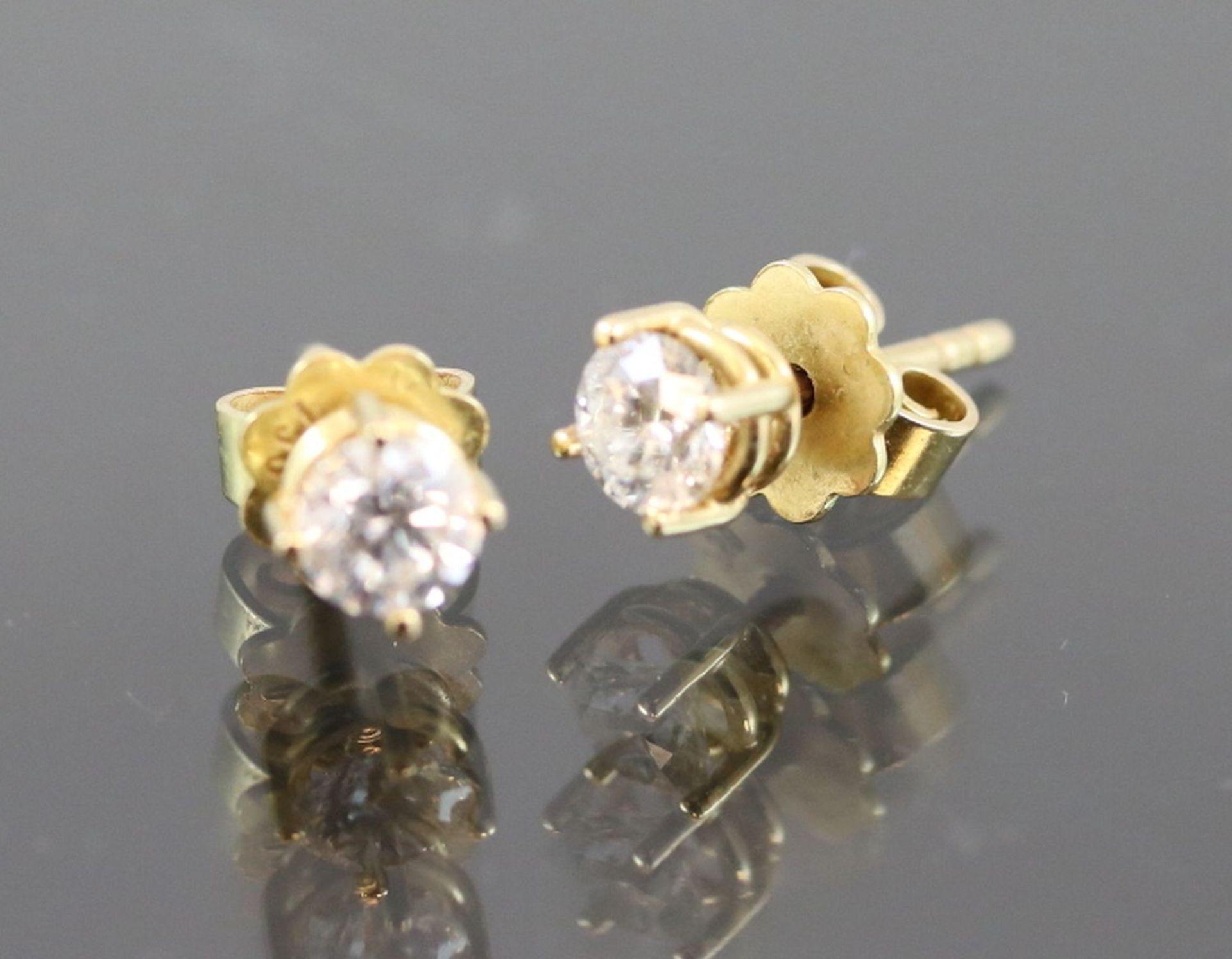 Los 22 - Brillant-Ohrringe, 750 Gelbgold1,7 Gramm 2 Brillanten, 0,62 ct., si1-h. Schätzpreis: 2000,-