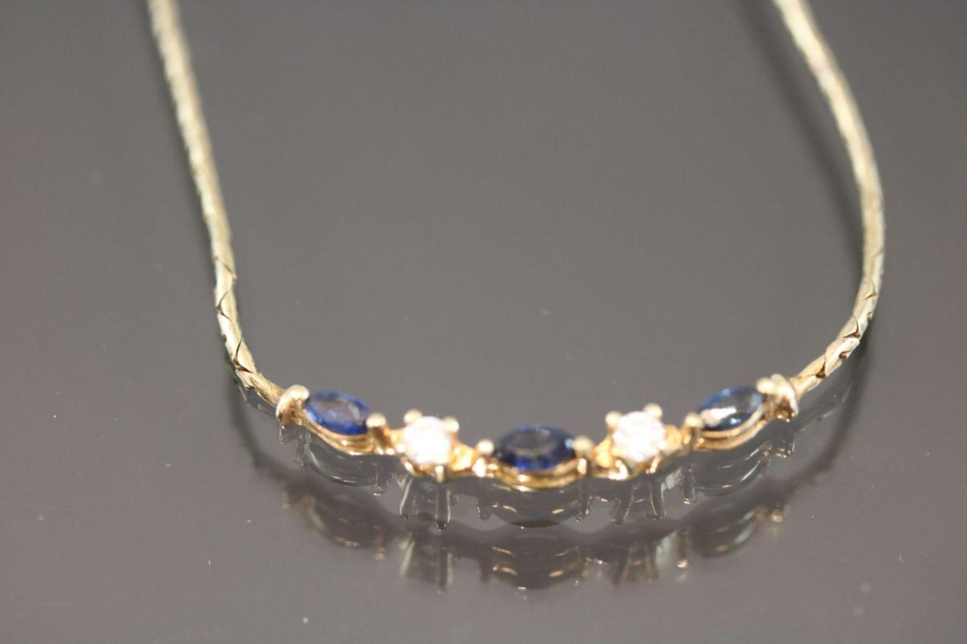 Saphir-Brillant-Collier, 585 Gold5,9 Gramm 2 Brillanten, 0,09 ct., w/si. Länge: 42 cm Schätzpreis: