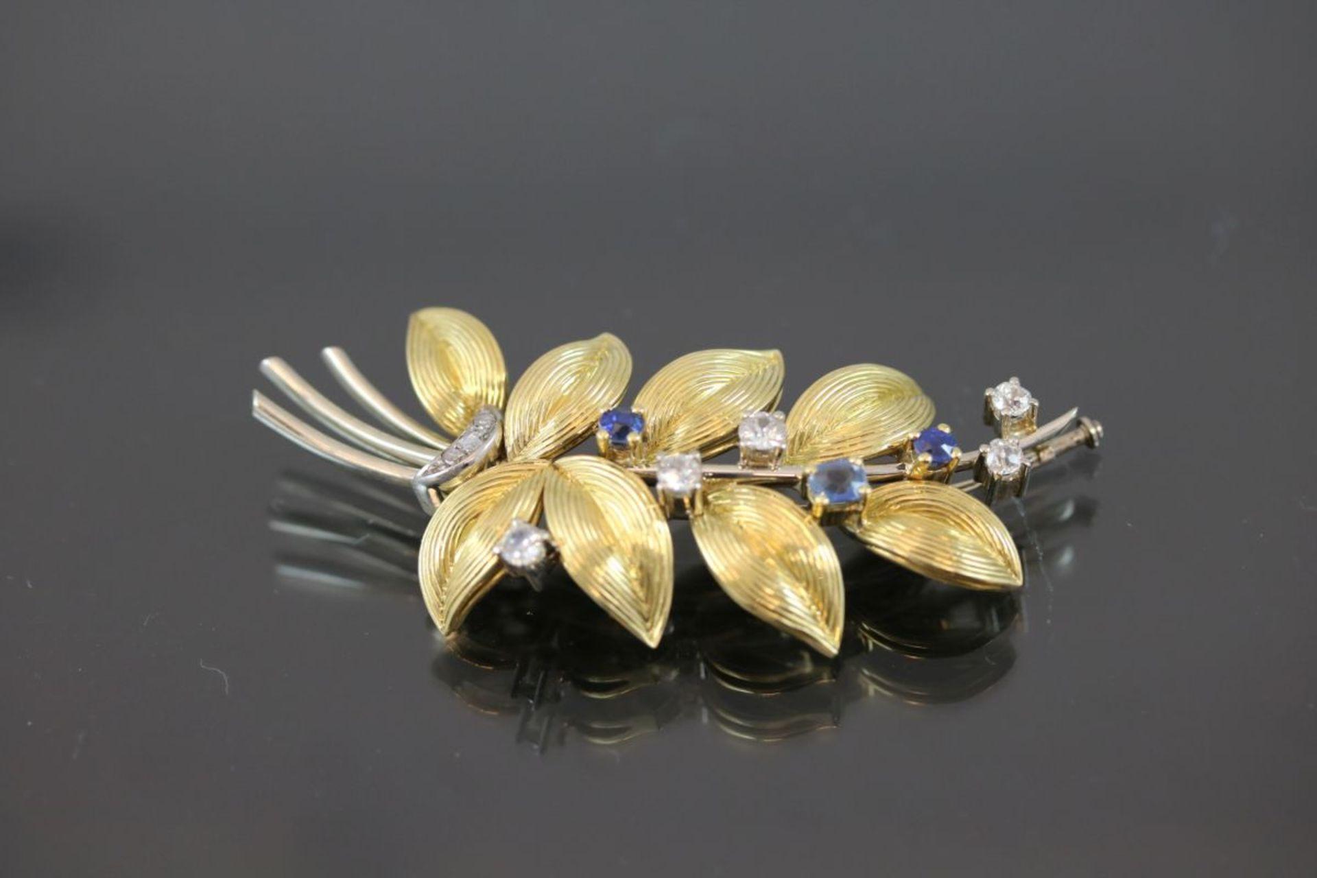 Saphir-Diamant-Brosche, 750 Gold15,6 Gramm 6 Diamanten, ca. 0,60 ct., tc/p1. Schätzpreis: 2000,-