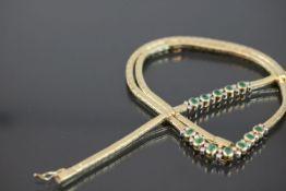Smaragd-Set, 585 Gelbgold44,3 Gramm Brillanten, ca. 1 ct., w/si. Set besteht aus einem Armband und