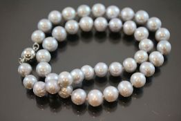 Perlenkette, Magnetschließe63,2 Gramm Perlen, Länge: 45 cm Perlendurchmesser: 9,5mmneu- - -25.00 %
