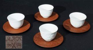 Vier Koppchen mit vier Böttger-Steinzeug-Untertassen. MEISSEN. Koppchen mit Böttger-Steinzeug-