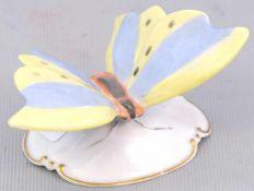 Schmetterlingauf Rocaillensockel, bunt bemalt, leicht best., H 5 cm, B 8 cm, FM Rosenthal