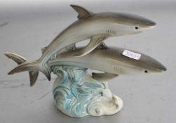 Zwei Haifischeauf Welle, bunt bemalt, H 12 cm, L 17 cm, FM Goebel