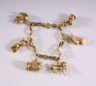 Bettelarmband aus 14 Karat GelbgoldKettenglieder-Armband mit 6 Anhänger u.a. Pudel, Elefant,