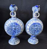 Lot 38 - A pair of large 19th century German Westerwald type stoneware armorial jugs,