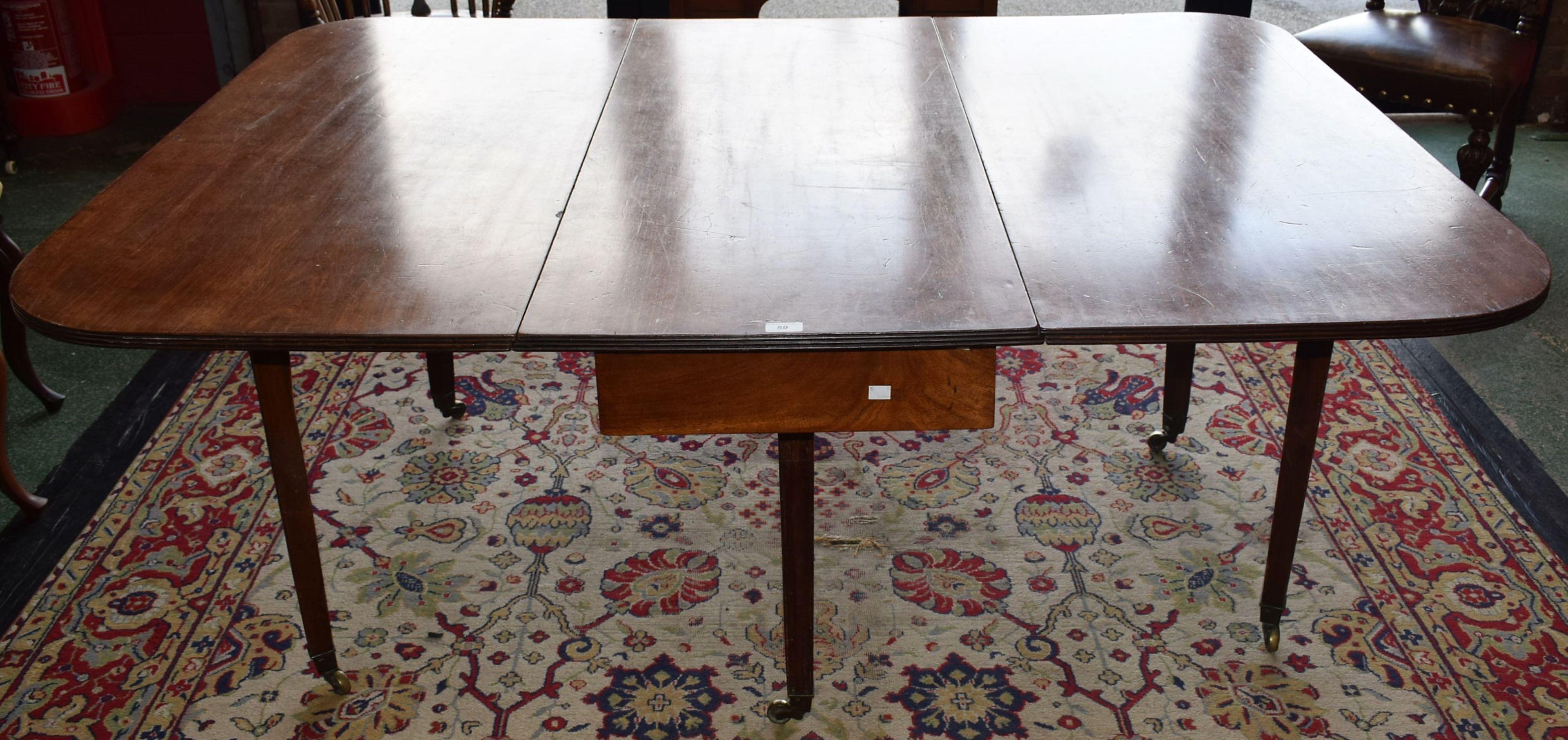 Lot 59 - A 19th century mahogany gateleg dining table,