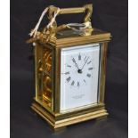 Lot 11 - A lacquered brass carriage clock, white rectangular enamel dial, Roman and Arabic numerals,