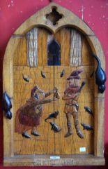 Lot 40 - A carved arched wood panel, The Pied Piper of Hamlyn, 61.5cm high, 39.