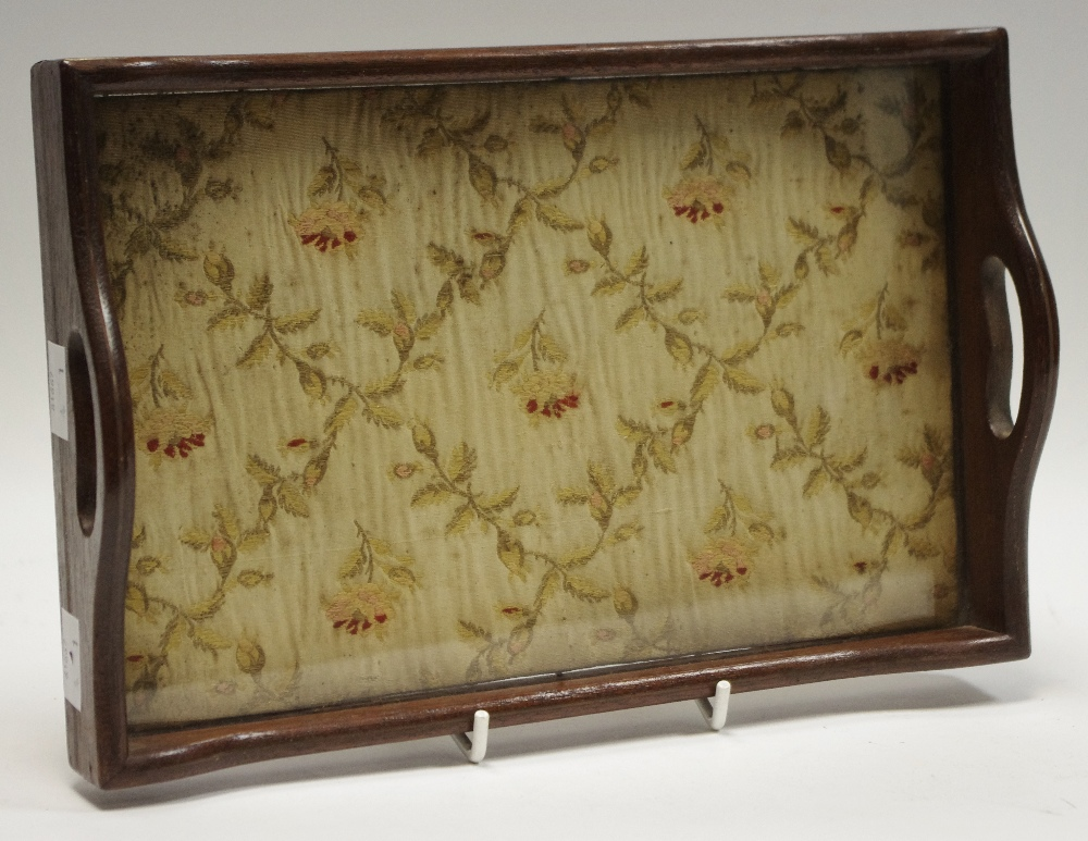 Lot 28 - A small two handled tray with silk embroidery to base.