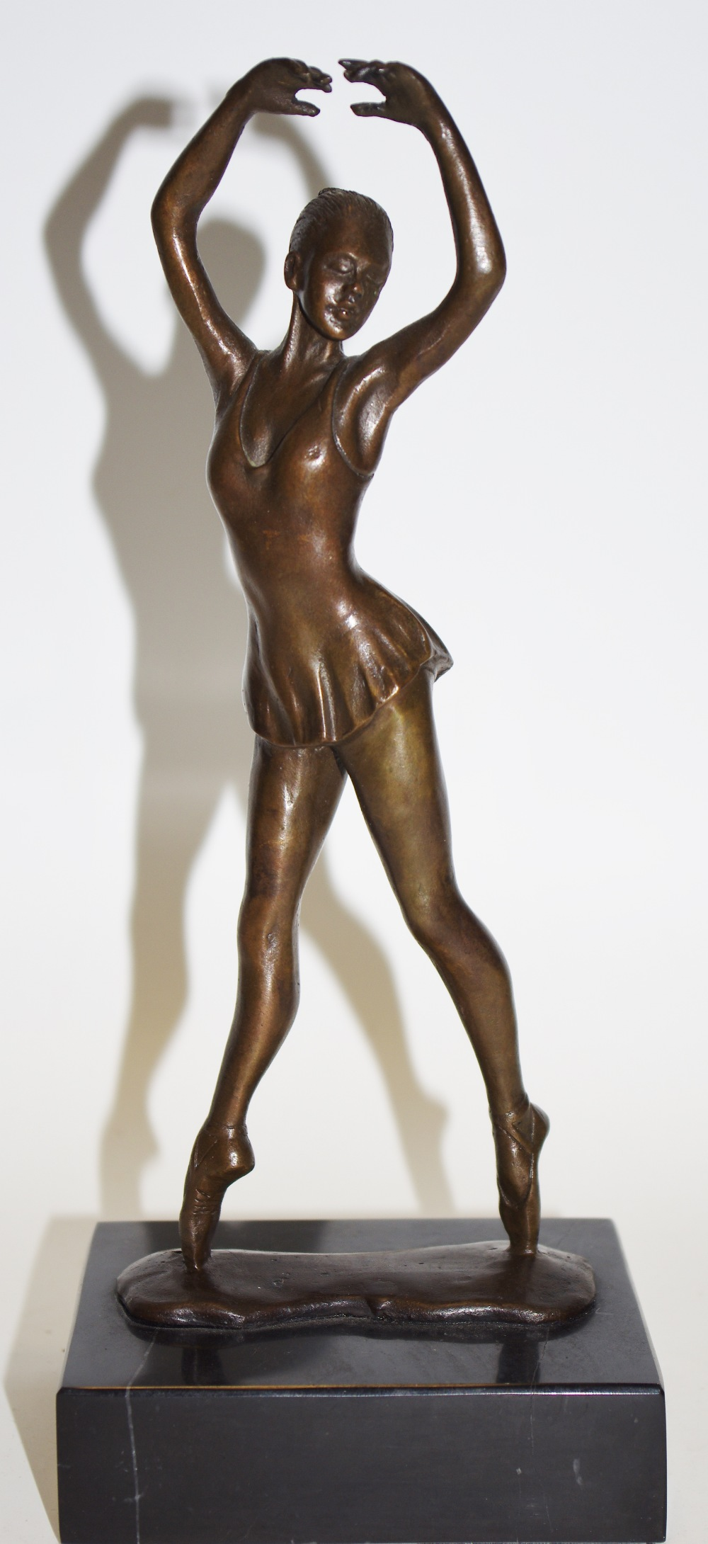 Lot 48 - A bronze ballet dancer, signed B. A.