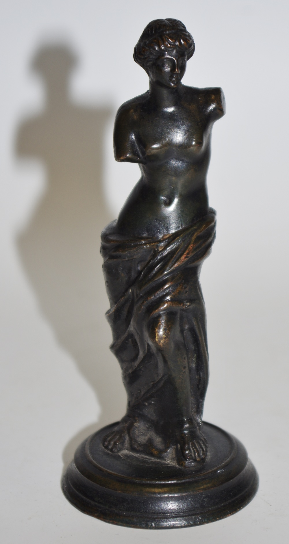 Lot 49 - A small dark patinated bronze, Venus De Milo, after the antique.