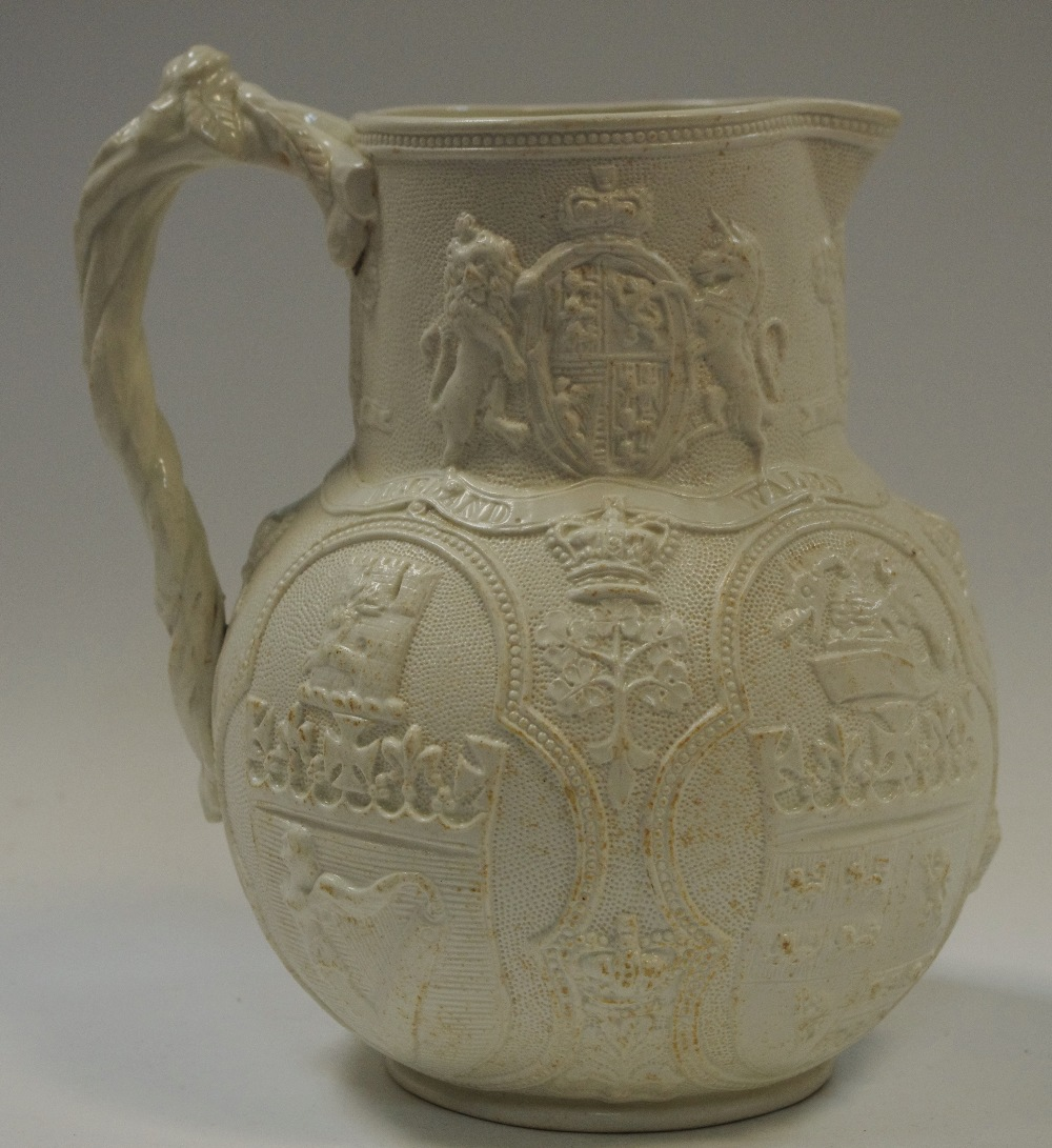 Lot 10 - A William Brownfield Cobridge relief moulded Albion jug, depicting the emblems of the Union, c.