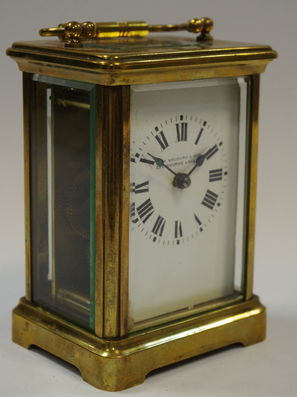 Lot 5 - An early 20th century lacquered brass carriage clock