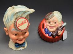 A reproduction cast metal Coca-Cola advertising money box; another,