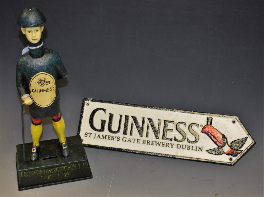 Lot 5012 - Advertising - a reproduction cast metal Guinness 'Bottle Man' money box; an advertising sign,