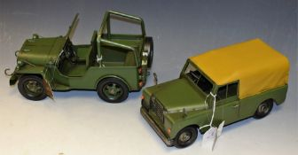 A reproduction pressed metal model, of a Jeep; another, similar, Jeep 4x4,