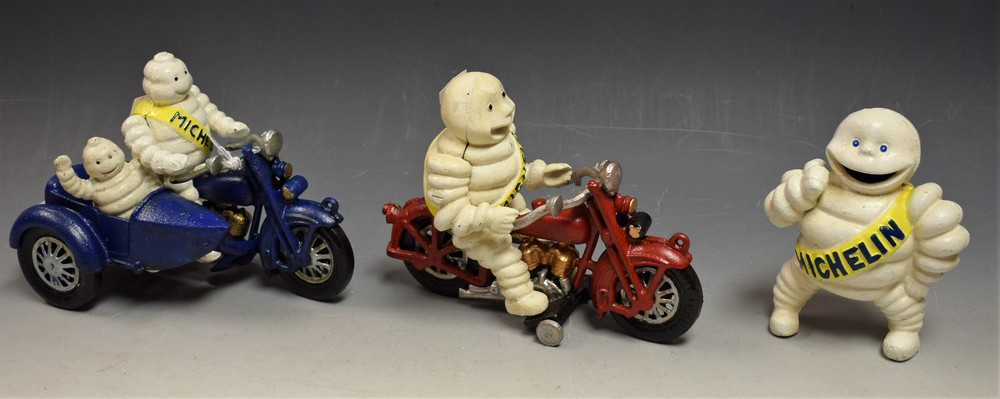 Lot 5016 - Advertising - a pair of reproduction cast metal Bibendum Michelin figures, on motorcycles; another,