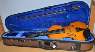 A student violin and bow, approx 51.