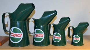 A graduated set of four reproduction metal oil jugs, advertising Castrol, the largest 27.