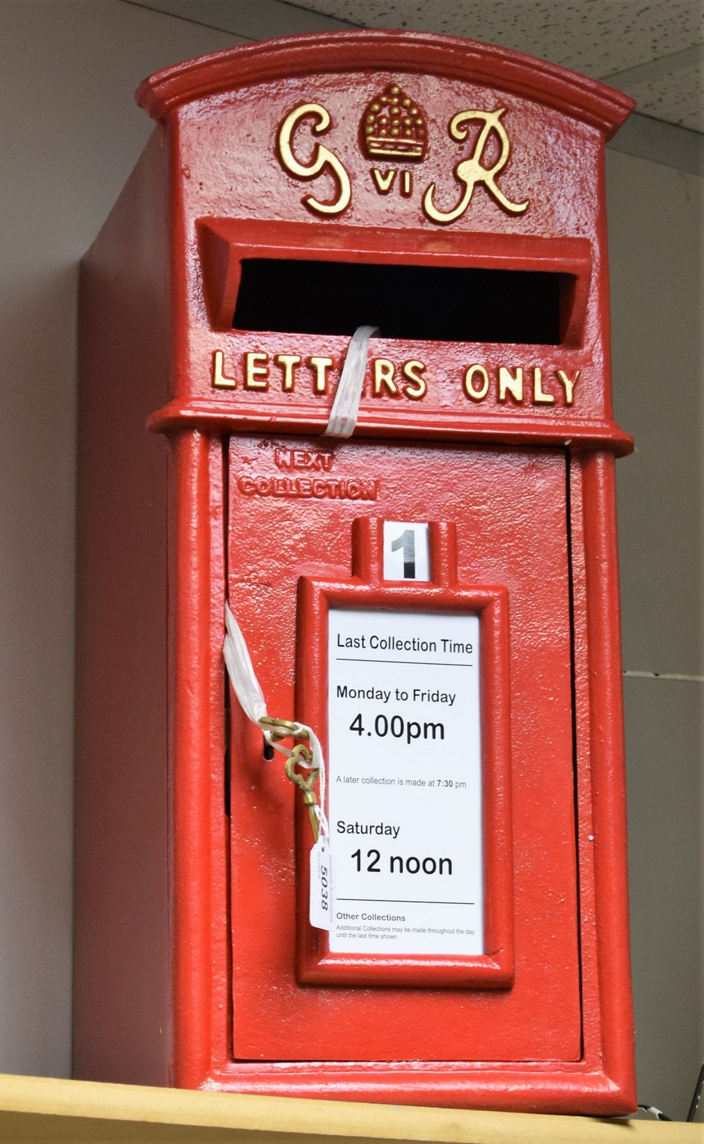 Lot 5038 - A reproduction cast metal George IV post box